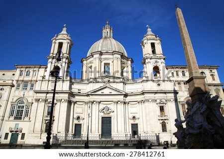 Saint Agnese in Agone with Egypts obelisk in Piazza Navona, Rome, Italy  - stock photo