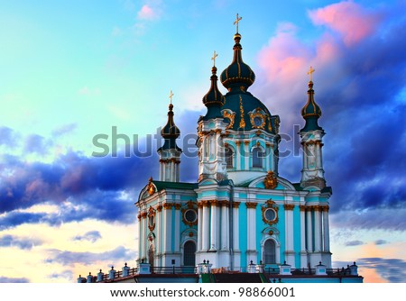 Saint Andrew's cathedral over colorful sunset sky in Kiev, Ukraine - stock photo