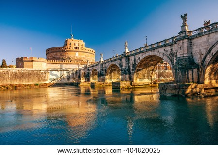 Saint Angel Castle and bridge over the Tiber river in Rome - stock photo