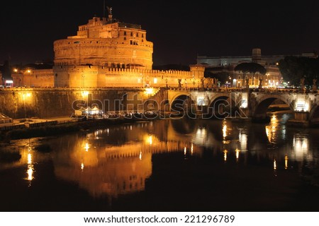 Saint Angel Castle and the Angels bridge by night, Italy - stock photo