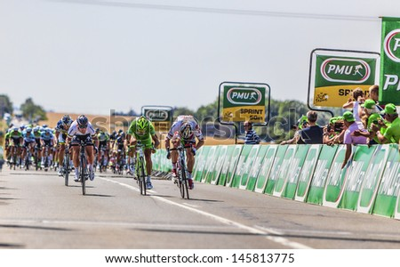 SAINT AOUSTRILLE,FRANCE- JUL 12:  Andre Greipel wins against  Mark Cavendish and Peter Sagan the intermediate sprint during the stage 13 of Le Tour de France on July 12, 2013 in Saint Aoustrille. - stock photo