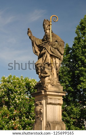 Saint Augustine statue holding a burning heart in hand, Charles bridge in Prague,Czech Republic - stock photo
