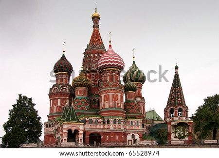 Saint Basil's Cathedral in focus between two trees. View from the back, Red Square behind the church.