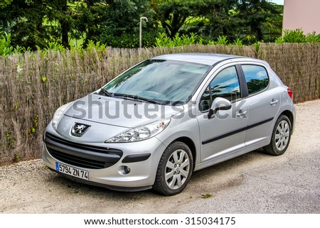 SAINT-BLAISE, FRANCE - AUGUST 7, 2014: Motor car Peugeot 207 at the town street.