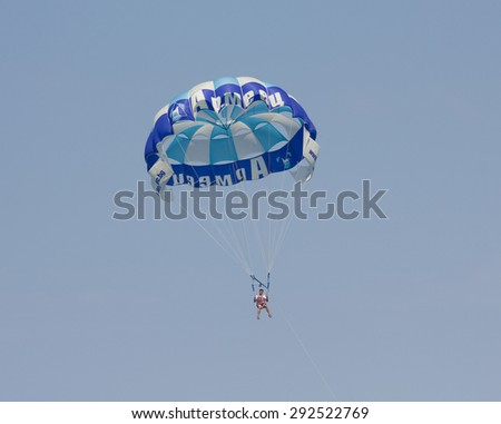 SAINT CONSTANTINE AND SAINT HELEN, BULGARIA - JULY 01, 2014: parachutist in the sky - summer sports offered for tourists on sea shore. - stock photo
