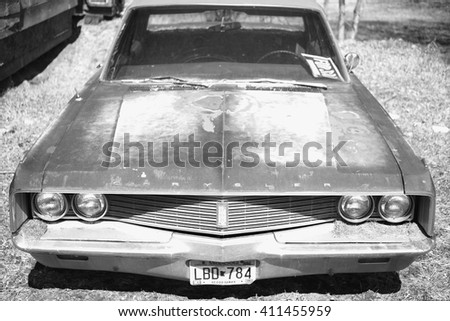 Saint Croix Falls, WI April-3-2016: American vintage car,close in Chrysler sedan - stock photo