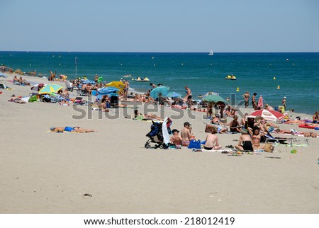 SAINT-CYPRIEN, FRANCE - JULY 22: People on the Mediterranean beach in southern France. July 22, 2008 in Saint-Cyprien, Pyrenees-Orientales, France