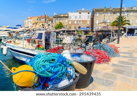 SAINT-FLORENT, CORSICA ISLAND - JUL 3, 2015: colorful fishing nets in port of Saint-Florent which is small cozy fishing village in northern Corsica.