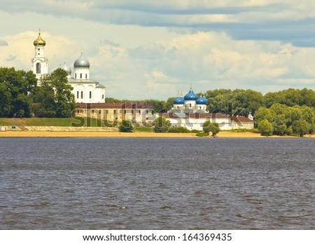 Saint George orthodox monastery on river Volhov near town Great Novgorod, Russia. - stock photo