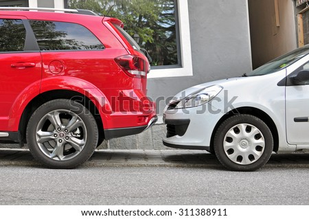 SAINT GERVAIS, FRANCE - AUGUST 13: Two cars parked in the street of Saint Gervais on August 13, 2015. Saint Gervais is a commune in the Haute-Savoie, France.