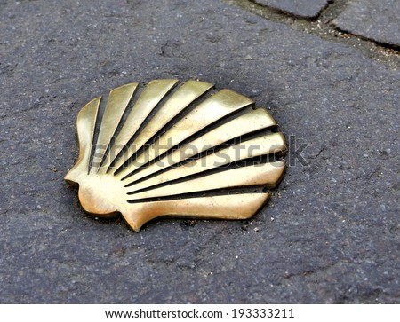 Saint James way shell golden metal on streets - stock photo