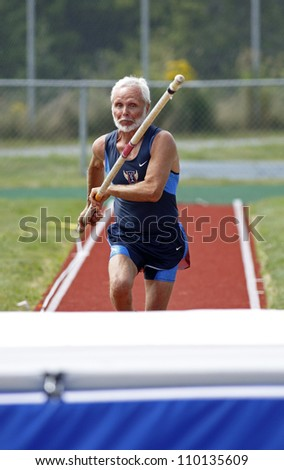 SAINT JOHN, CANADA - AUG 10: Howard Booth of USA competes in the pole vault at the North, Central American & Caribbean Masters Track & Field Championships August 10, 2012 in Saint John, Canada.