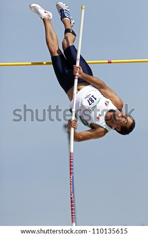 SAINT JOHN, CANADA - AUG 10: Pole vaulter Jose Francisco Gonzalez of Mexico at the North, Central American & Caribbean Masters Track & Field Championships August 10, 2012 in Saint John, Canada. - stock photo