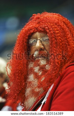 SAINT JOHN, CANADA - March 19: A Canadian fan wears his team's colors on his beard and hair at the Ford World Women's Curling Championship March 19, 2014 in Saint John, Canada. - stock photo