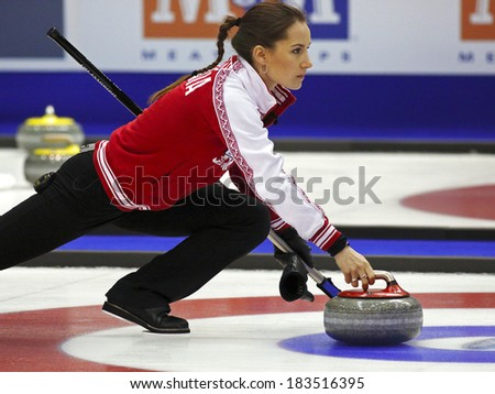 SAINT JOHN, CANADA - March 19: Anna Sidorova of Russia delivers her rock at the Ford World Women's Curling Championship March 19, 2014 in Saint John, Canada. - stock photo