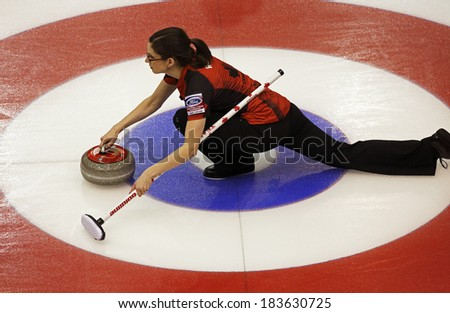 SAINT JOHN, CANADA - March 19: Canada's Lisa Weagle slides through the rings on a stone delivery at the Ford World Women's Curling Championship March 19, 2014 in Saint John, Canada. - stock photo