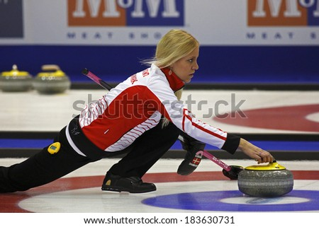 SAINT JOHN, CANADA - March 19: Madeleine Dupont of Denmark delivers her stone at the Ford World Women's Curling Championship March 19, 2014 in Saint John, Canada. - stock photo