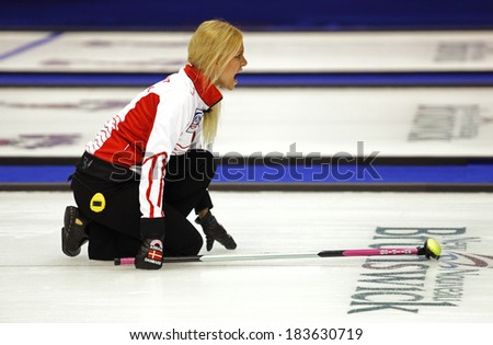 SAINT JOHN, CANADA - March 19: Madeleine Dupont of Denmark instructs her sweepers at the Ford World Women's Curling Championship March 19, 2014 in Saint John, Canada. - stock photo