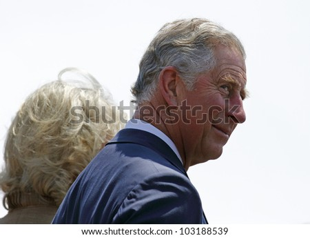 SAINT JOHN, CANADA - MAY 21: Charles, Prince of Wales, takes part in a ceremony at the Marco Polo cruise terminal with Camilla, Duchess of Cornwall, on May 21, 2012, in Saint John, Canada. - stock photo