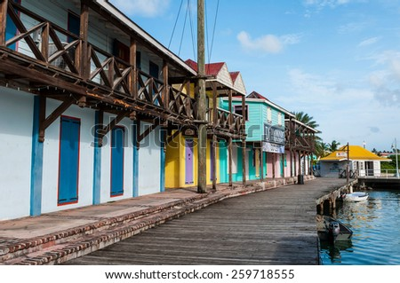 SAINT JOHN'S, ANTIGUA - AUGUST 24: wooden houses and pier at Saint John's Port on August 24, 2011 in Saint John's, Antigua. It is the chief port of the island of Antigua. - stock photo