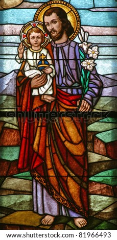 Saint Joseph holding baby Jesus - stock photo