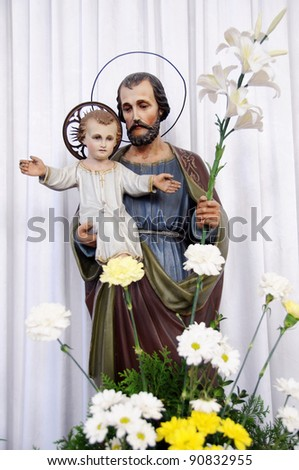 Saint Joseph with little Jesus - stock photo