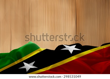 Saint Kitts and Nevis flag and wood background