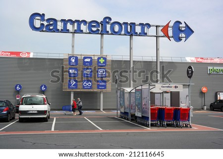 SAINT-LO, FRANCE - JULI 23:  Facade of Carrefour hypermarket - Carrefour is a French multinational retailer, and one of the largest hypermarket chains in the world on Juli 23, 2014 in Normandy, France - stock photo