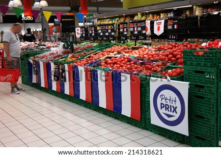 SAINT-LO, FRANCE - JULY 23: Attention for french products in a Carrefour hypermarket. Carrefour is a French retailer, and a large supermarket chain worldwide on July 23, 2014 in Normandy, France  - stock photo