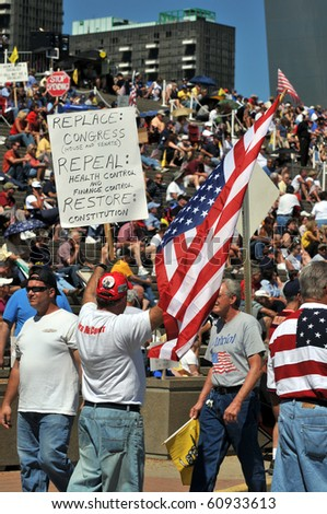 SAINT LOUIS, MISSOURI - SEPTEMBER 12: Crowd holding signs at rally of the Tea Party Patriots in Downtown Saint Louis under the Arch, on September 12, 2010 - stock photo