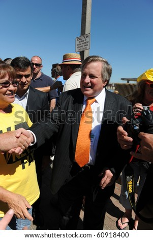 SAINT LOUIS, MISSOURI - SEPTEMBER 12: Dick Morris shaking hands at rally of the Tea Party Patriots in Downtown Saint Louis under the Arch, on September 12, 2010 in Saint Loius, Missouri - stock photo