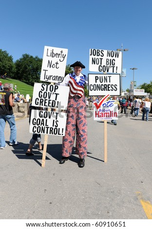 SAINT LOUIS, MISSOURI - SEPTEMBER 12: Man dressed in Patriotic clothing holding signs at rally of the Tea Party Patriots in Downtown Saint Louis under the Arch, on September 12, 2010 - stock photo