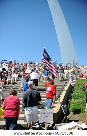 SAINT LOUIS, MISSOURI - SEPTEMBER 12: Man holding flag at rally of the Tea Party Patriots in Downtown Saint Louis under the Arch, on September 12, 2010 - stock photo