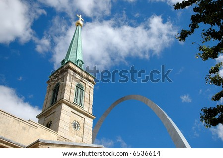 Saint Louis Old Cathedral with Arch in the background. - stock photo