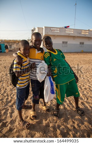 SAINT LOUIS, SENEGAL, DECEMBER 17: Unidentified group of Kids playing on the beach and smiling, Senegal, December 17, 2013 - stock photo