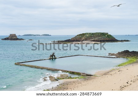 Saint Malo beach, Fort National and rocks during Low Tide. Brittany, France, Europe.  - stock photo