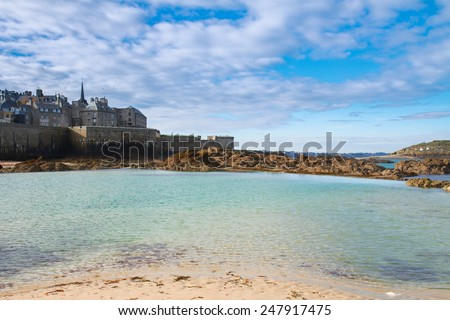 Saint-Malo old intramuros city over tidal waters , Brittany, France - stock photo