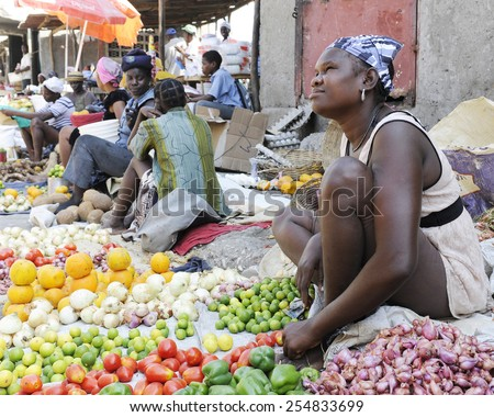 SAINT MARC, HAITI - FEBRUARY 22, 2013:  Women selling fruits and veggies along the street in St. Marc, Haiti. - stock photo