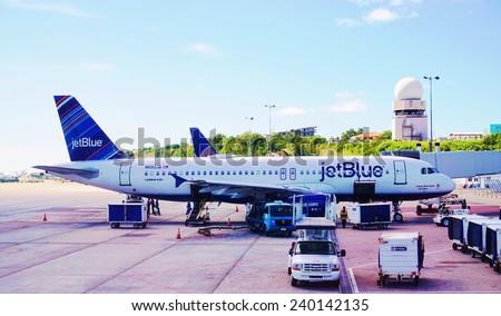 SAINT MARTIN, DUTCH ANTILLES --30 NOVEMBER 2014-- An Airbus A320 from lowcost American carrier JetBlue sits at the gate at the Princess Juliana International Airport in Saint Martin (Sint Maarten).  - stock photo