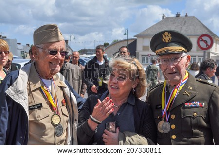 SAINT MERE EGLISE, FRANCE - JUNE 05, 2014: People attending the D-Day celebrations of WW2 in Normandy