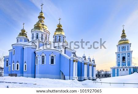 Saint Michael Gilded Orthodox cathedral in Kiev in snow, Ukraine - stock photo