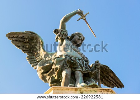 Saint Michael statue at top of Castel Sant`Angelo in Rome, Italy - stock photo