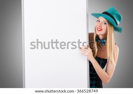 Saint Patrick concept with woman and board - stock photo