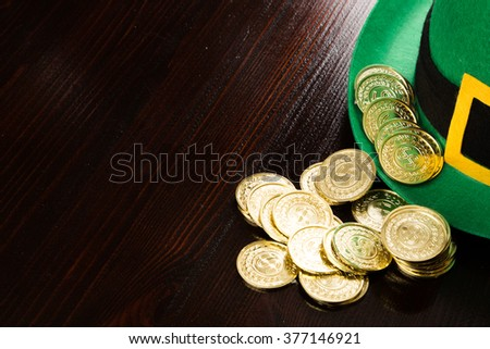 Saint Patrick's gold coins and green hat - stock photo