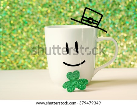Saint Patricks Day green clover with happy face on white mug - stock photo