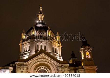 Saint Paul Cathedral copper top dome illuminated at night in Saint Paul Minnesota - stock photo