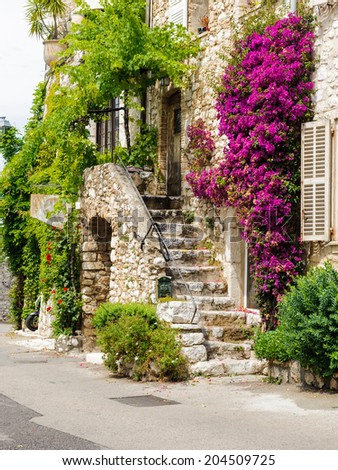 SAINT-PAUL-DE-VENCE, FRANCE - JUN 25, 2014: Beautiful old architecture of Saint Paul de Vence, one of the oldest towns of the Frence Riviera. Town of painters and galleries - stock photo