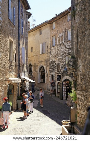SAINT-PAUL-DE-VENCE, FRANCE - MAY 12, 2013: Beautiful narrow street with old houses in Saint Paul de Vence, one of the oldest towns of the Provence, France, famous town of painters and galleries.