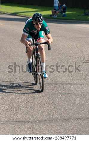 SAINT PAUL, MN/USA - JUNE 17, 2015: Pro cyclist Jean-Michel Lachance races in Stage One time trial at the prestigious North Star Grand Prix pro cycling event in Saint Paul. - stock photo