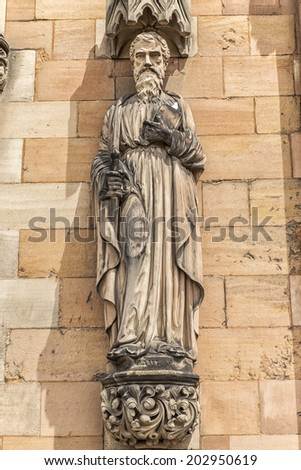 Saint Paul statue on the west front of Lichfield Cathedral.  Lichfield Cathedral in Staffordshire, England, Britain. - stock photo